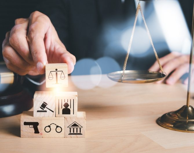 Male,Lawyer,Hand,Holding,Law,Icon,On,Wooden,Cube,With